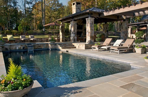 16 this is my kind of pool and entertaining area i really like the enclosed top area with the tv and patio the pool is simple with nice slate stone work - Backyard Pools Designs